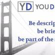 "YouDescribe logo over a black and white image of the Golden Gate Bridge: it says ""be descriptive, be brief, be part of the solution"""