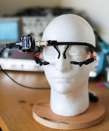 Experimental equipment: head-mounted eye-tracking goggles and head movement sensor