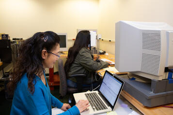 researchers looking at a computer monitor