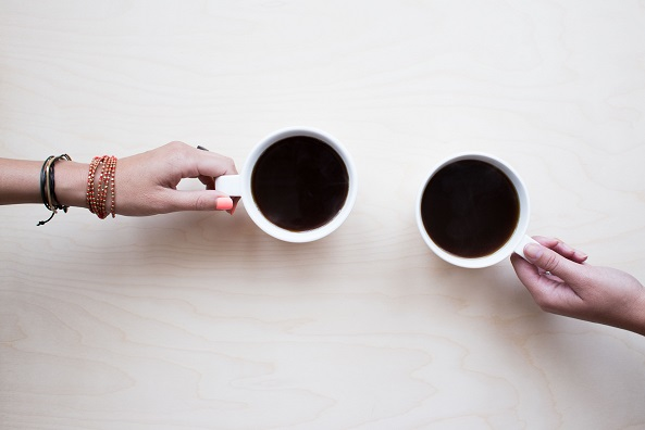 two people enjoying a cup of coffee